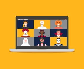 People in costumes having virtual meeting on laptop