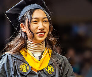 Woman smiling in graduation garb