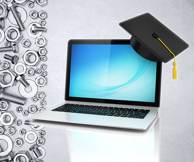 Laptop with mortarboard on it
